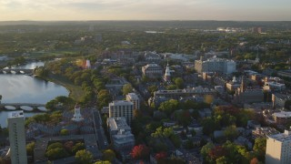 AX146_027 - 6k stock footage aerial video orbiting Harvard University, Cambridge, Massachusetts, sunset