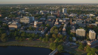 AX146_029 - 6k stock footage aerial video orbiting Lowell House, Harvard University, Cambridge, Massachusetts, sunset