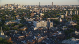 AX146_033 - 6k stock footage aerial video flying by Harvard University, Downtown Boston, Massachusetts, sunset