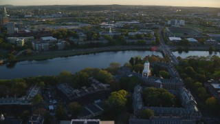 AX146_038 - 6k stock footage aerial video approaching Harvard Business School, Harvard University, Massachusetts, sunset