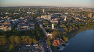 AX146_043 - 6k stock footage aerial video approaching Eliot House from Charles River, Harvard University, Massachusetts, sunset