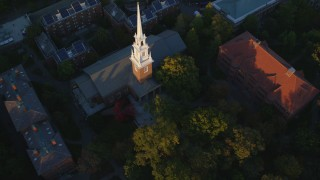 AX146_045 - 6k stock footage aerial video tilting to a bird's eye view, Memorial Church, Harvard University, Massachusetts, sunset