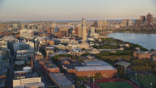 AX146_049 - 6k stock footage aerial video flying by Massachusetts Institute of Technology, Cambridge, Massachusetts, sunset