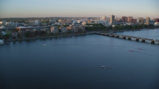 AX146_051 - 6k stock footage aerial video approaching Massachusetts Institute of Technology, Massachusetts, sunset