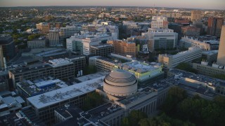 AX146_053 - 6k stock footage aerial video of Picower Insitute for Learning and Memory, Stata Center, Massachusetts Institute of Technology, Massachusetts, sunset