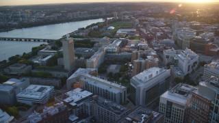 AX146_056 - 6k stock footage aerial video flying by Massachusetts Institute of Technology, Massachusetts, sunset