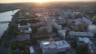 AX146_057 - 6k stock footage aerial video flying by the Massachusetts Institute of Technology, Massachusetts, sunset
