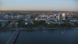 AX146_059 - 6k stock footage aerial video flying by the Massachusetts Institute of Technology, Massachusetts, sunset