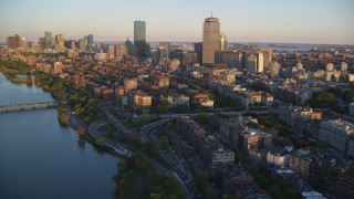 AX146_060 - 6k stock footage aerial video flying by Back Bay and skyscrapers, Downtown Boston, Massachusetts, sunset
