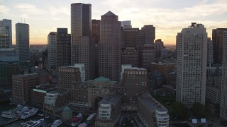 AX146_083 - 6k aerial stock footage video flying by Rowes Wharf and Downtown Boston, Massachusetts, sunset