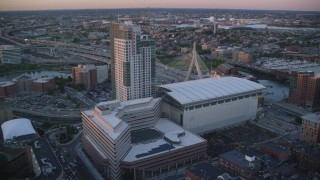 AX146_087 - 6k stock footage aerial video flying over TD Garden, approaching Zakim Bridge, Boston, Massachusetts, sunset
