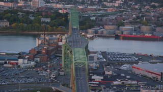 AX146_089 - 6k stock footage aerial video flying by the Tobin Memorial Bridge, Charlestown, Massachusetts, sunset