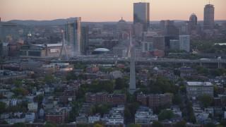 AX146_090 - 6k stock footage aerial video orbiting the Bunker Hill Monument, Charlestown, Massachusetts, sunset
