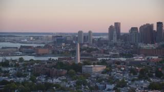 AX146_092 - 6k stock footage aerial video orbiting the Bunker Hill Monument, Charlestown, Massachusetts, sunset