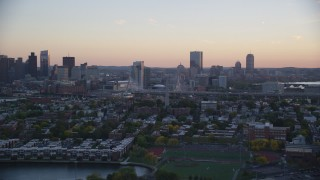 AX146_096 - 6k stock footage aerial video flying by Bunker Hill Monument, waterfront property, Charlestown, Massachusetts, sunset