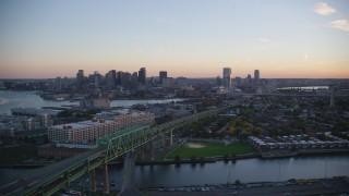 AX146_097 - 6k stock footage aerial video flying by Tobin Memorial Bridge, skyline, Charlestown, Massachusetts, sunset