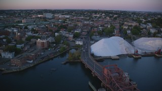 AX146_098 - 6k stock footage aerial video flying by apartment buildings, Chelsea, Massachusetts, sunset