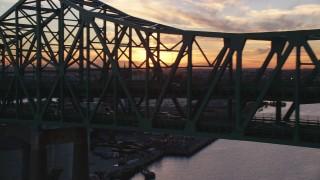 AX146_106 - 6k stock footage aerial video flying by the Tobin Memorial Bridge, Charlestown, Massachusetts, sunset
