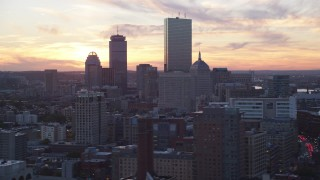 AX146_113 - 6k stock footage aerial video flying by downtown skyscrapers, Downtown Boston, Massachusetts, sunset