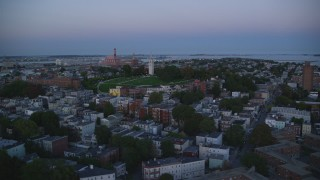 AX146_117 - 6k stock footage aerial video of Dorchester Heights Monument, row houses, South Boston, Massachusetts, twilight