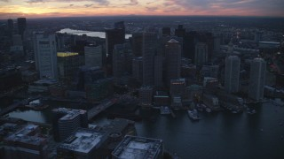 AX146_127 - 6k stock footage aerial video flying by skyscrapers, Downtown Boston, Massachusetts, twilight
