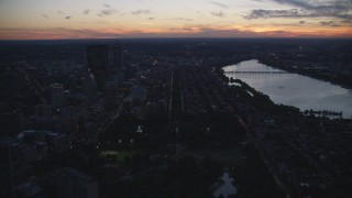 AX146_144 - 6k stock footage aerial video approaching skyscrapers, Back Bay row houses, Downtown Boston, Massachusetts, twilight