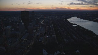 AX146_145 - 6k stock footage aerial video Back Bay row houses and skyscrapers, Downtown Boston, Massachusetts, twilight