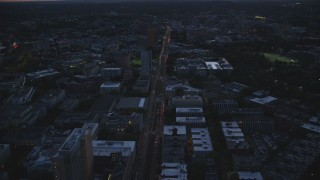 AX146_148 - 6k stock footage aerial video flying over Huntington Avenue, Museum of Fine Arts Boston, Massachusetts, twilight