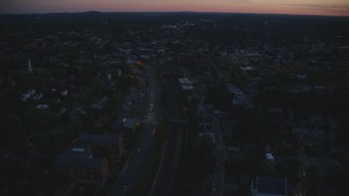 AX146_149 - 6k stock footage aerial video flying over Columbus Avenue, train tracks, Jamaica Plain, Massachusetts, twilight