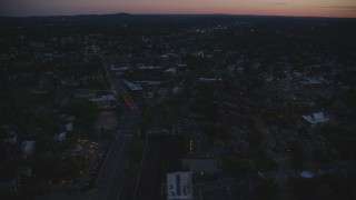 AX146_150 - 6k stock footage aerial video flying over apartment buildings, Jamaica Plain, Massachusetts, twilight