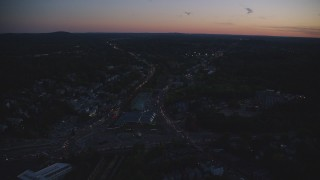 AX146_153 - 6k stock footage aerial video approaching suburban neighborhoods, Roslindale, Massachusetts, twilight