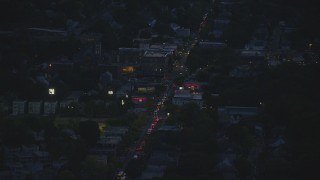 AX146_154 - 6k stock footage aerial video flying by Washington Street, Roslindale, Massachusetts, night