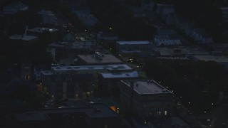 AX146_155 - 6k stock footage aerial video flying by Washington Street, Roslindale, Massachusetts, night
