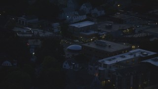 AX146_156 - 6k stock footage aerial video flying by apartments, revealing Corinth Street, Roslindale, Massachusetts, night