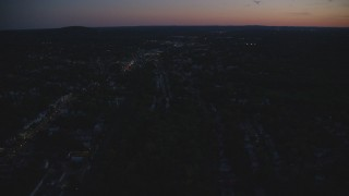 AX146_157 - 6k stock footage aerial video flying over suburban neighborhood, Hyde Park, Massachusetts, night