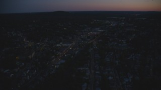 AX146_158 - 6k stock footage aerial video flying over suburbs, approaching strip mall, Hyde Park, Massachusetts, night