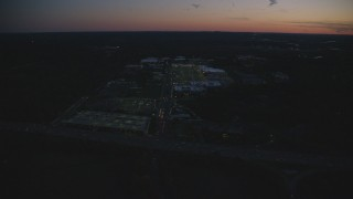 AX146_163 - 6k stock footage aerial video approaching an office building and tilt down, Westwood, Massachusetts, night