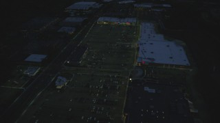 AX146_164 - 6k stock footage aerial video flying over office buildings, approach strip mall, Westwood, Massachusetts, night