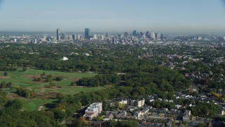 AX147_002 - 6k stock footage aerial video approaching Downtown Boston city sprawl and skyline, Massachusetts