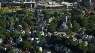 AX147_004 - 6k stock footage aerial video flying over suburban homes, church and tree lined streets, Dorchester, Massachusetts