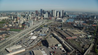 AX147_006 - 6k stock footage aerial video flying over industrial area to Downtown Boston skyscrapers, Fort Point Channel, Massachusetts