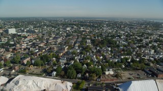 AX147_011 - 6k stock footage aerial video flying over residential neighborhood and row houses, Chelsea, Massachusetts
