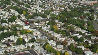 AX147_013 - 6k stock footage aerial video flying away from suburban neighborhood and tree lined streets, Chelsea, Massachusetts