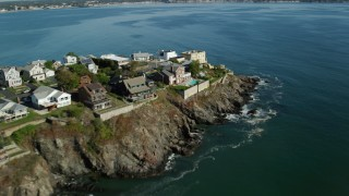 AX147_018 - 6k stock footage aerial video flying by mansions in a coastal community on the bay, Nahant, Massachusetts
