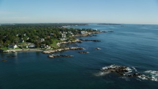 AX147_019 - 6k stock footage aerial video approaching a coastal community along Massachusetts Bay and Atlantic Ocean, Swampscott, Massachusetts