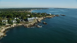 AX147_020 - 6k stock footage aerial video approaching coastal mansions among trees, Swampscott, Massachusetts