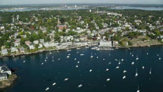 AX147_025 - 6k stock footage aerial video flying by coastal community and harbor with boats, Marblehead, Massachusetts