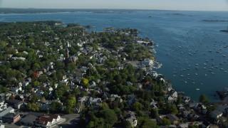 AX147_030 - 6k stock footage aerial video orbiting Abbott Hall, coastal community along harbor, Marblehead, Massachusetts
