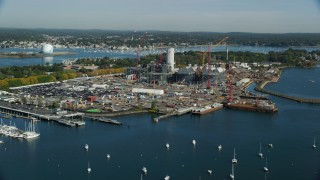 AX147_035 - 6k stock footage aerial video flying by a natural gas power plant along the harbor, Salem, Massachusetts