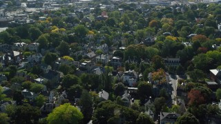 AX147_046 - 6k stock footage aerial video orbiting a residential neighborhood among trees, autumn, Salem, Massachusetts